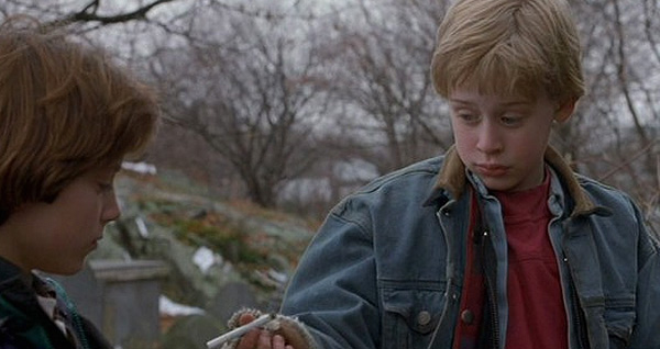 Macaulay Culkin (left) appears with Elijah Wood in a scene from the 1993 film 'The Good Son.' Culkin plays a psychotic young boy who stays with his aunt and tries to influence his cousin, played by Wood.