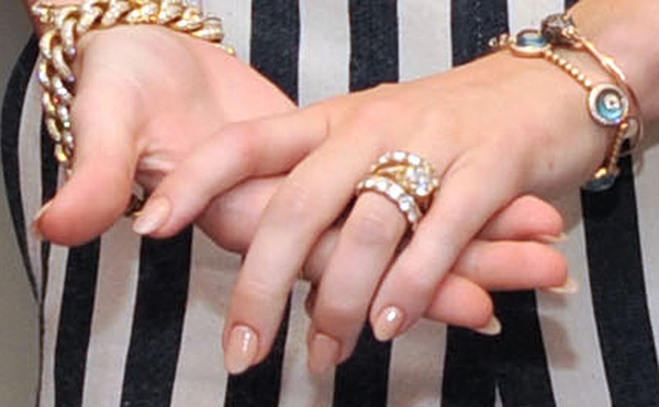Miley Cyrus wears her engagement ring to the...