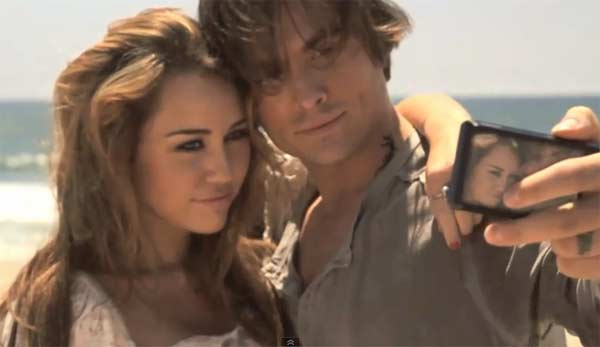 Zegers and Cyrus appear in a scene from the 2011 music video 'The Big Bang.'