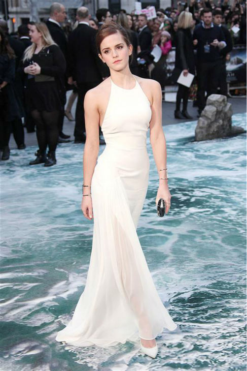 Emma Watson, wearing a one-of-a-kind, flowing, white Ralph Lauren collection halter gown, appears at the 'Noah' London premiere on March 31, 2014. She plays Ila, wife of Noah's son Shem, in the film.