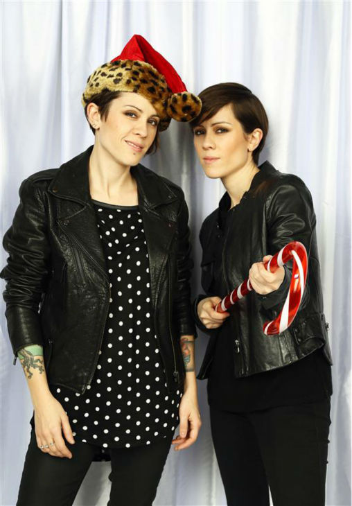 Members of the duo Tegan and Sara pose in a holiday-themed photo booth at Z100&#39;s Jingle Ball 2013 on Dec. 13, 2013, just before Christmas. <span class=meta>(Sara Jaye Weiss  &#47; Startraksphoto.com)</span>