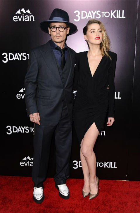 "<div class=""meta image-caption""><div class=""origin-logo origin-image ""><span></span></div><span class=""caption-text"">Johnny Depp and reported fiancee Amber Heard, who wore a diamond ring, appear at the premiere of the movie '3 Days To Kill' in Los Angeles on Feb. 12, 2014. It was reported in January that the two are engaged, although the pair has not confirmed this. (Sara De Boer / Startraksphoto.com)</span></div>"