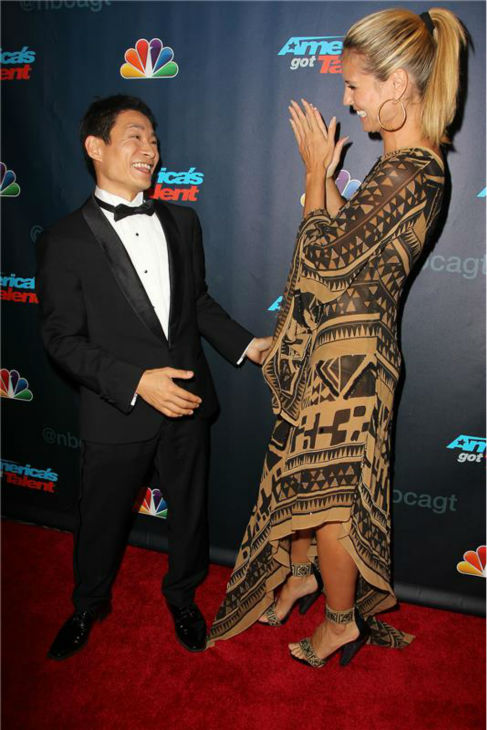 "<div class=""meta ""><span class=""caption-text "">'America's Got Talent' co-judge Heidi Klum kisses season 8 winner and dancer Kenichi Ebina on the red carpet after the finale at Radio City Music Hall in New York on Sept. 18, 2013. (Amanda Schwab / Startraksphoto.com)</span></div>"