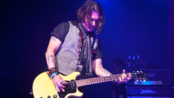 Johnny Depp appears in concert at the premiere...