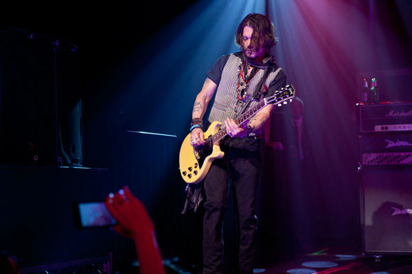 "<div class=""meta image-caption""><div class=""origin-logo origin-image ""><span></span></div><span class=""caption-text"">Johnny Depp appears in concert at the premiere party for Warner Bros. Pictures' and Village Roadshow Pictures' 'Dark Shadows,' a Warner Bros. Pictures release, in Hollywood on May 8, 2012. (Greg Zabilski)</span></div>"