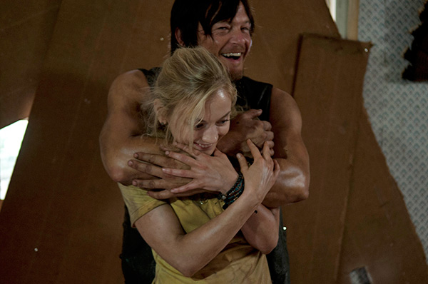 "<div class=""meta ""><span class=""caption-text "">Norman Reedus (Daryl Dixon) hugs Emily Kinney (Beth Greene) on the set of AMC's 'The Walking Dead' episode 12, 'Still,' which aired on March 2, 2014. (Gene Page / AMC)</span></div>"