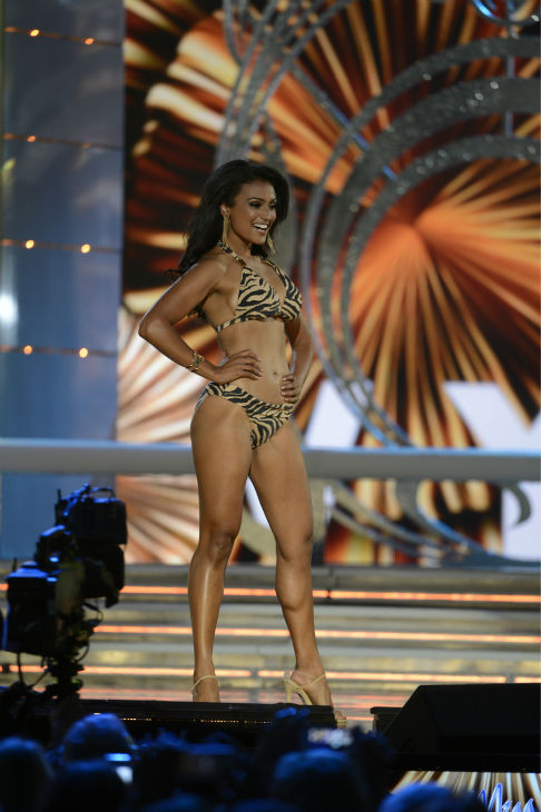 "<div class=""meta ""><span class=""caption-text "">Nina Davuluri, Miss New York, poses in a bikini during the Miss America 2014 pageant in Atlantic City, New Jersey on Sept. 15, 2013. She won the competition, becoming the first Indian-American to secure the crown. (ABC Photo / Ida Mae Astute)</span></div>"