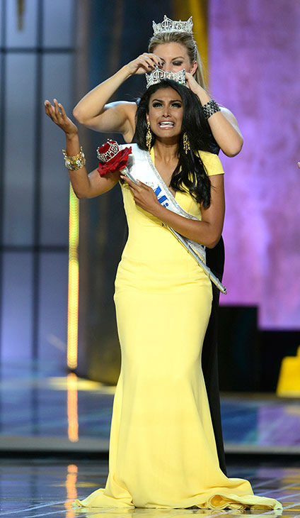 "<div class=""meta image-caption""><div class=""origin-logo origin-image ""><span></span></div><span class=""caption-text"">Nina Davuluri, Miss New York, is crowned Miss America 2014 by Miss America 2013, Mallory Hagan, also of New York, at the annual pageant in Atlantic City, New Jersey on Sept. 15, 2013. (ABC Photo / Ida Mae Astute)</span></div>"