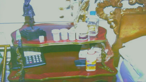 Oct. 5, 2011: During Conrad Murray&#39;s involuntary manslaughter trial, L.A. Coroner&#39;s Office investigator Elissa Fleak identified items she recovered from the bedroom where Michael Jackson was found lifeless. Pictured: Various prescription medications on the nightstand near the bed, Bayer aspirin and an empty bottle of Naked Juice. <span class=meta>(OTRC)</span>