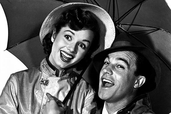 Debbie Reynolds and Gene Kelly appear in a still from their 1952 film, 'Singin' in the Rain.'