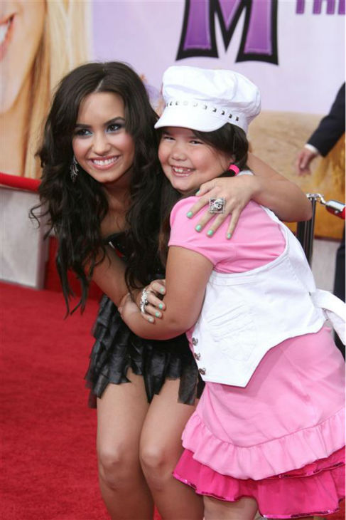 Demi Lovato appears with sister Mardison De La Garza of &#39;Desperate Housewives&#39; at the premiere of &#39;Hannah Montana The Movie&#39; in Los Angeles on April 2, 2009. <span class=meta>(Jen Lowery &#47; Startraksphoto.com)</span>