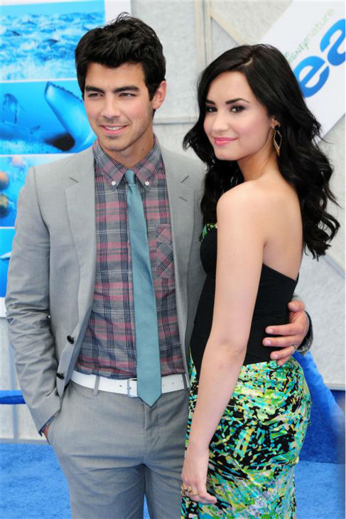 Demi Lovato appears with Joe Jonas of the Jonas Brothers at the premiere of &#39;Oceans&#39; in Los Angeles on April 17, 2010. <span class=meta>(Kyle Rover &#47; Startraksphoto.com)</span>