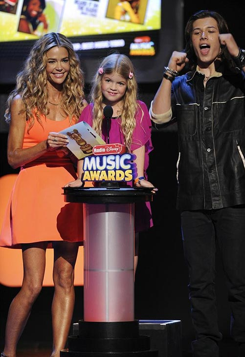 Denise Richards, daughter Lola, 7, and actor Leo Howard appear on stage at the 2013 Radio Disney Music Awards at the Nokia Theatre L.A. Live on April 27, 2013.