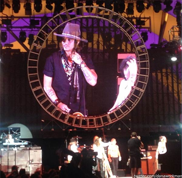 Johnny Depp appears on stage with Aerosmith at the rock bands concert at the Hollywood Bowl in Los Angeles on Aug. 6, 2012, as seen in this fan photo. - Provided courtesy of twitter.com/danaworkman / instagram.com/p/OBEelwHuLK/