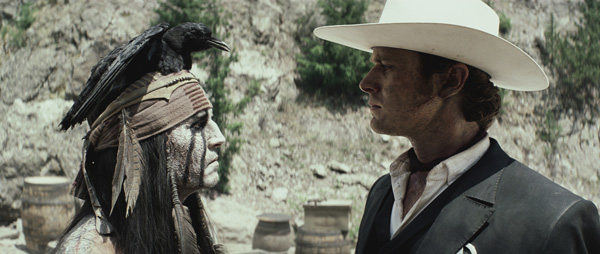 Johnny Depp and Armie Hammer appear as Tonto and...