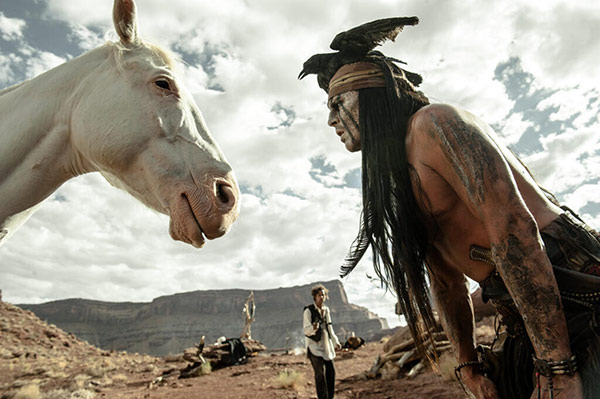 Johnny Depp challenges 'The Lone Ranger's horse to a staring contest in a scene from Walt Disney's 2013 movie 'The Lone Ranger.'
