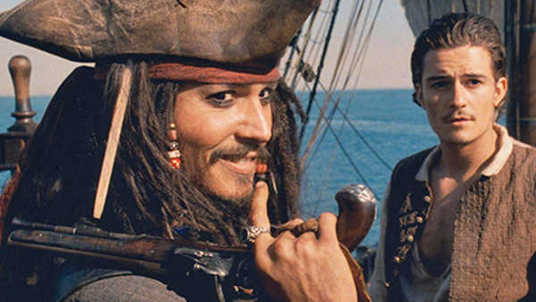 Johnny Depp appears as captain Jack Sparrow, with Orlando Bloom as Will Turner, in a scene from the 2003 movie &#39;Pirates of the Caribbean: The Curse of the Black Pearl.&#39; <span class=meta>(Walt Disney Pictures &#47;  Jerry Bruckheimer Films)</span>