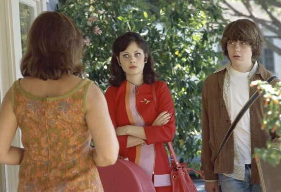 Zooey Deschanel appears in a scene from the 2000 film &#39;Almost Famous.&#39;Deschanel appears in the film as Anita Miller and stars alongside Kate Hudson, Anna Paquin and Fairuza Balk. Many peg this as Deschanel&#39;s breakout role. <span class=meta>(Columbia Pictures &#47; DreamWorks SKG)</span>