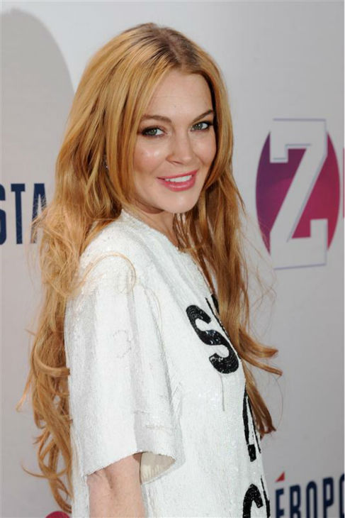 Lindsay Lohan walks the red carpet at the 2013 Z100 Jingle Ball at Madison Square Garden in New York on Dec. 13, 2013. <span class=meta>(Bill Davila &#47; Startraksphoto.com)</span>