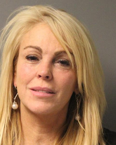 Dina Lohan, mother of actress Lindsay Lohan and former star of E! reality show &#39;Living Lohan,&#39; was arrested on suspicion of drunk driving in New York on Sept. 12, 2013. Police say cops pulled her over for speeding and arrested her after a breath test showed her blood alcohol concentration &#40;BAC&#41; was 0.20 -- more than twice the legal limit in New York.  &#40;Pictured: Dina Lohan appears in a New York State Police mug shot taken after her Sept. 12, 2013 DWI arrest.&#41; <span class=meta>(New York State Police)</span>