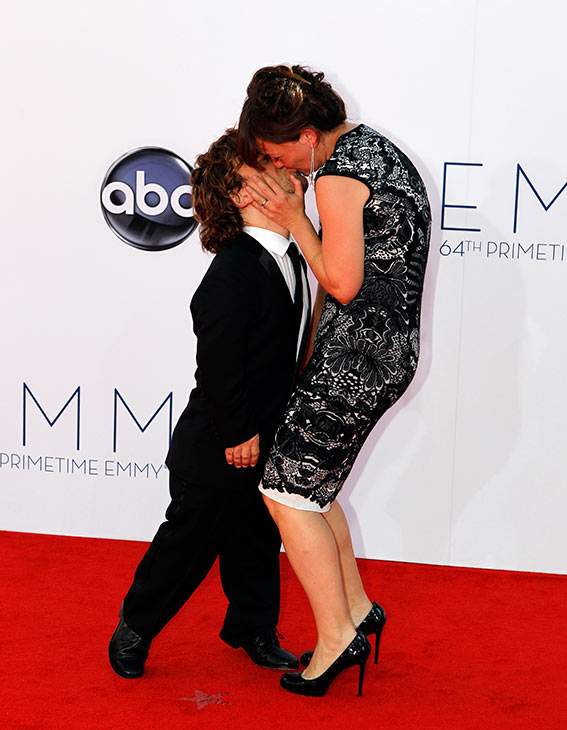 Peter Dinklage, who plays Tyrion Lannister on the HBO show &#39;Game of Thrones,&#39; kisses his wife, Erica, on the red carpet at the 2012 Emmy Awards in Los Angeles on Sept. 23, 2012. <span class=meta>(ABC &#47; Rick Rowell)</span>