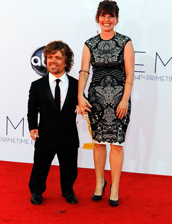 "<div class=""meta ""><span class=""caption-text "">Peter Dinklage, who plays Tyrion Lannister on the HBO show 'Game of Thrones,' and his wife, Erica, walk the red carpet at the 2012 Emmy Awards in Los Angeles on Sept. 23, 2012. (ABC / Rick Rowell)</span></div>"