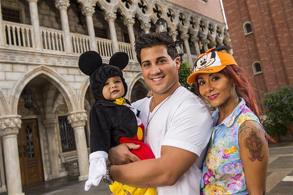 Nicole 'Snooki' Polizzi appears with son Lorenzo and fiance Jionni LaValle at the Italy pavillion at the Epcot theme park at Walt Disney World in Lake Buena Vista, Florida on Sept. 27, 2013.