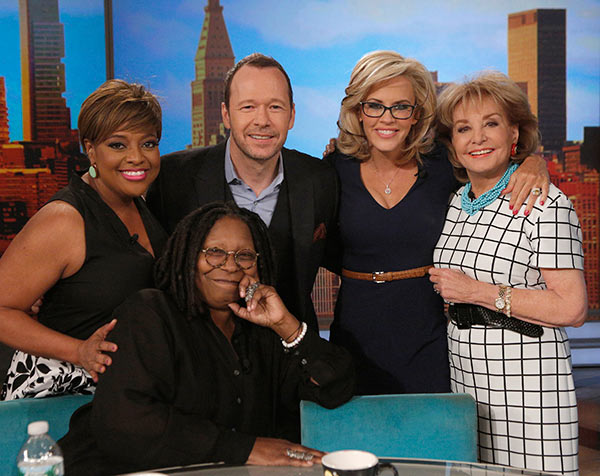 Jenny McCarthy, wearing a yellow sapphire engagement ring, and fiance Donnie Wahlberg pose with her co-hosts Whoopi Goldberg, Sherri Shepherd and Barbara Walters on ABC&#39;s &#39;The View&#39; on April 16, 2014. McCarthy, a co-host on the show, announced their engagement that morning. <span class=meta>(ABC Photo &#47; Heidi Gutman)</span>
