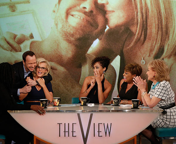 Jenny McCarthy, wearing a yellow sapphire engagement ring, is embraced by fiance Donnie Wahlberg on ABC&#39;s &#39;The View&#39; on April 16, 2014. McCarthy, a co-host on the show, announced their engagement that morning. Also pictured: Guest co-host Sage Steele and regular co-hosts Sherri Shepherd and Barbara Walters. <span class=meta>(ABC Photo &#47; Heidi Gutman)</span>