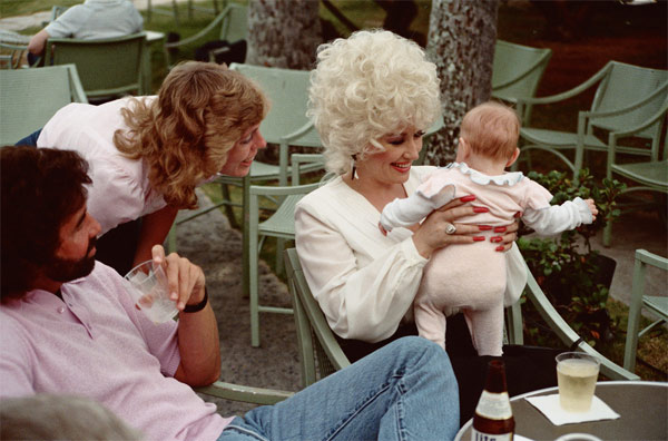 "<div class=""meta ""><span class=""caption-text "">Alan Light describes this photo, which he says was taken in Hawaii: 'Dolly Parton holds my niece Amy as my sister Jan looks on. Photo taken at the Kahala Hilton Hotel, May 1984.' (Alan Light / flickr.com/photos/alan-light/)</span></div>"