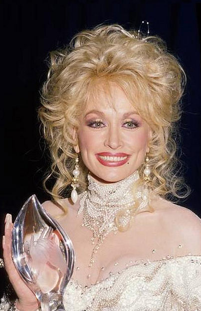 Dolly Parton appears at the 1988 People's Choice Awards. The singer and actress won two awards - one for Favorite All-Around Female Entertainer and one for Favorite Female Performer in a New TV Program. The