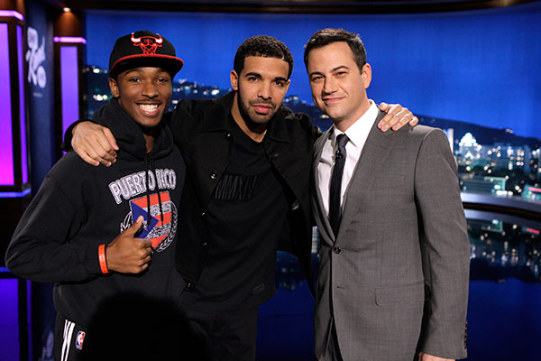 "<div class=""meta image-caption""><div class=""origin-logo origin-image ""><span></span></div><span class=""caption-text"">Rapper Drake appears with ABC host Jimmy Kimmel and a man he talked to on a street in Hollywood, California as part of an 'I Witness News' segment taped for 'Jimmy Kimmel Live!,' on April 10, 2014. The rapper, who appeared on the series to promote his upcoming ESPYs 2014 hosting gig, interviewed people in disguise and asked them what they think about him and got insulted to his face. This man, however, turned out to be a fan and got to appear on stage on the show. (ABC Photo / Randy Holmes)</span></div>"