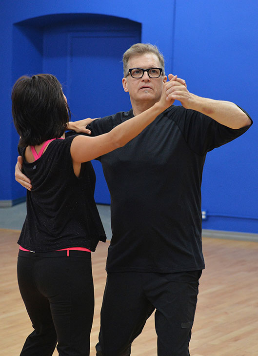 &#39;Dancing With The Stars&#39; celebrity contestant Drew Carey appears with partner Cheryl Burke at a reheasal before the season 18 premiere of the ABC show on March 17, 2014. <span class=meta>(ABC Photo &#47; Rick Rowell)</span>