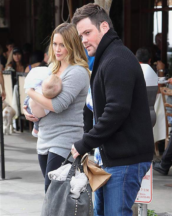 Hilary Duff, carrying baby Luca, and husband Mike Comrie appear in Los Angeles on Oct. 20, 2012. It was announced on Jan. 10, 2014 that the couple had split after three years of marriage. <span class=meta>(Norman Scott &#47; Startraksphoto.com)</span>