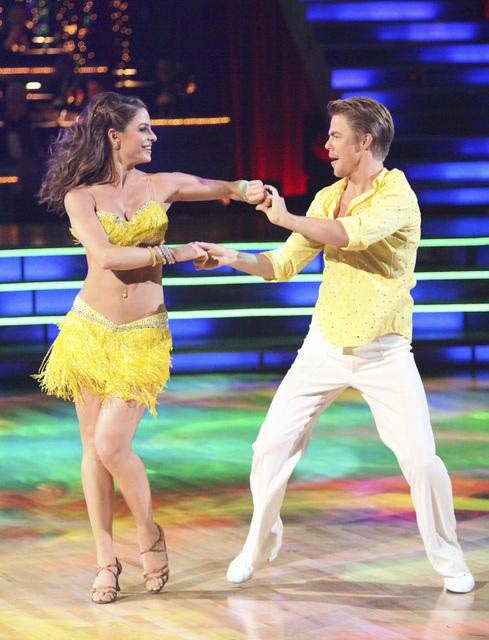 "<div class=""meta image-caption""><div class=""origin-logo origin-image ""><span></span></div><span class=""caption-text"">TV personality Maria Menounos and her partner Derek Hough react to being safe from elimination on 'Dancing With The Stars: The Results Show' on Tuesday, April 17, 2012. The pair received 27 out of 30 points from the judges for their Salsa on week five of 'Dancing With The Stars,' which aired on April 16, 2012. (ABC Photo)</span></div>"