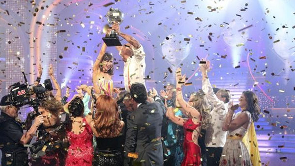 'All My Children' actor and Iraq War veteran J.R. Martinez and his partner Karina Smirnoff react to winning season 13 of 'Dancing With The Stars' on Tuesday, November 22 as their fellow cast members cheer around them.