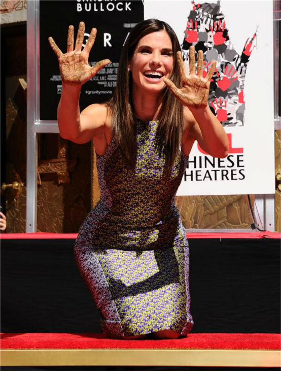 Sandra Bullock removes her hands from wet cement at a ceremony at the TCL Chinese Theatre in Hollywood on Sept. 25, 2013. <span class=meta>(Sara De Boer &#47; Startraksphoto.com)</span>