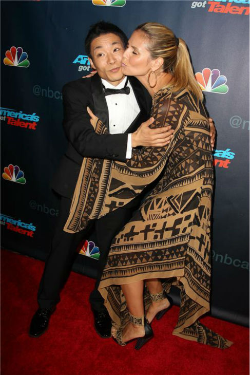 "<div class=""meta ""><span class=""caption-text "">'America's Got Talent' co-judge Heidi Klum kisses season 8 winner and dancer Kenichi Ebina on the red carpet after the finale at Radio City Music Hall in New York on Sept. 18, 2013. (Photo/Amanda Schwab)</span></div>"