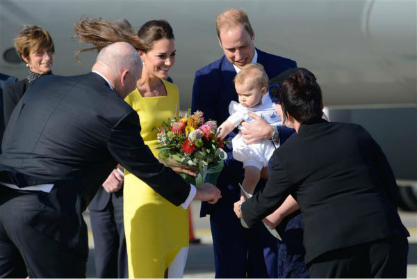 Kate Middleton, aka Catherine, Duchess of Cambridge, son Prince George and husband Prince William are greeted by officials after they land in Sydney, Australia, as part of their Royal Tour. <span class=meta>(Paul McConnell &#47; Startraksphoto.com)</span>