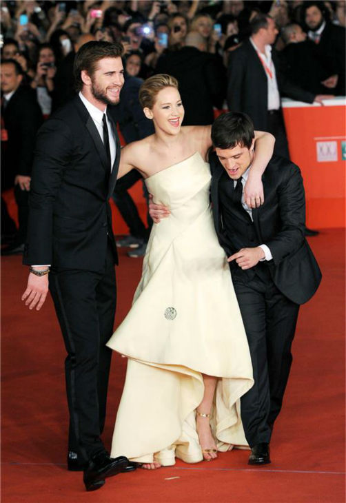 "<div class=""meta image-caption""><div class=""origin-logo origin-image ""><span></span></div><span class=""caption-text"">Liam Hemsworth, Jennifer Lawrence and Josh Hutcherson appear at the premiere of 'The Hunger Games: Catching Fire' during the 2013 Rome Film Festival in Rome, Italy on Nov. 14, 2013. (Eric Vandeville / Startraksphoto.com)</span></div>"