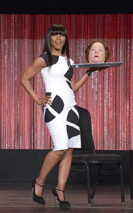 Angela Bassett appears on stage holding prop of Kathy Bates&#39; head on a plate, as seen in an episode of the FX series &#39;American Horror Story: Coven,&#39; at a PaleyFest event celebrating the show, presented by the Paley Center for Media, at the Dolby Theatre in Hollywood, California on March 28, 2014. She is wearing a black and white La Petite Robe by Chiara Boni cocktail dress. <span class=meta>(Rob Latour for Paley Center for Media)</span>