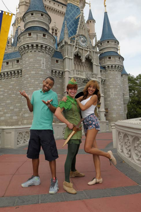 TV personality Terrence J (left), from BET's '106 and Park,' and supermodel Selita Ebanks (right) strike a pose with Peter Pan on March 9, 2012 at Magic Kingdom in Walt Disney World Lake Buena Vista, Florida.