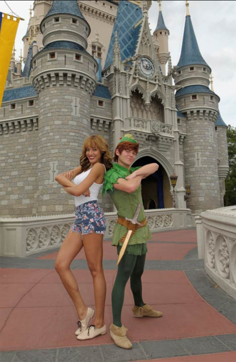 Supermodel Selita Ebanks (right) strikes a pose with Peter Pan on March 9, 2012 at Magic Kingdom in Walt Disney World Lake Buena Vista, Florida.