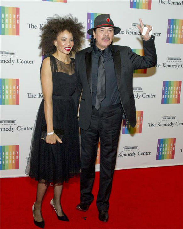 "<div class=""meta ""><span class=""caption-text "">Carlos Santana and wife Cindy Blackman attend a ceremony for the 2013 Kennedy Center honorees in Washington D.C. on Dec. 8, 2013. Santana was one of the five. (Ron Sachs / Startraksphoto.com)</span></div>"