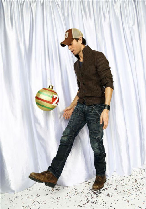 Enrique Iglesias poses in a holiday-themed photo booth at Z100&#39;s Jingle Ball 2013 on Dec. 13, 2013, just before Christmas. <span class=meta>(Sara Jaye Weiss  &#47; Startraksphoto.com)</span>