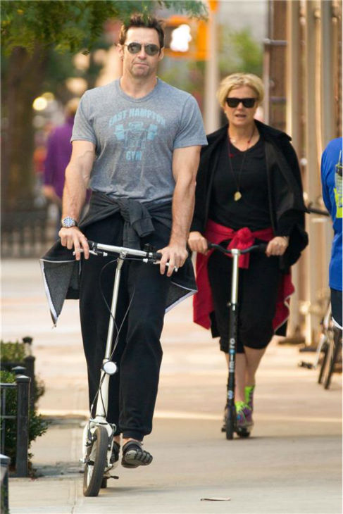 Hugh Jackman and his wife, Deborra-Lee Furness, ride scooters in New York City on Oct. 22, 2013. <span class=meta>(Freddie Baez &#47; Startraksphoto.com)</span>