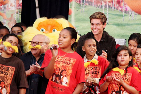 Zac Efron and Danny DeVito read the book 'The Lorax' to schoolchildren in honor of Dr. Seuss's birthday and as part of the Read Across America Program in New York on March 2, 2012, ahead of the release of the movie 'The Lorax.'