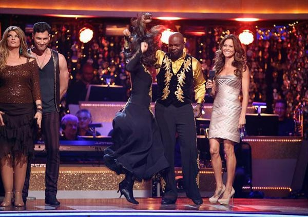 Retired NFL star Emmitt Smith and his partner Cheryl Burke react to being safe from elimination on &#39;Dancing With The Stars: The Results Show&#39; on Tuesday, Oct. 9, 2012.  The pair received 25 out of 30 points from the judges for their Paso Doble on &#39;Dancing With The Stars: All-Stars,&#39; which aired on October 8, 2012.  <span class=meta>(ABC Photo)</span>