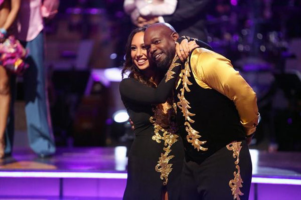 Retired NFL star Emmitt Smith and his partner Cheryl Burke react to being safe from elimination on 'Dancing With The Stars: The Results Show' on Tuesday, Oct. 9, 2012.