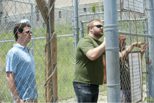 "<div class=""meta image-caption""><div class=""origin-logo origin-image ""><span></span></div><span class=""caption-text"">Executive Producer David Alpert, Show Creator Robert Kirkman and Co-Executive Producer/SFX Makeup Supervisor Greg Nicotero appear on the set of AMC's 'The Walking Dead'swhile filming episode 2 of season 4, titled 'Infected,' which aired on Oct. 27, 2013.  (Gene Page / AMC)</span></div>"